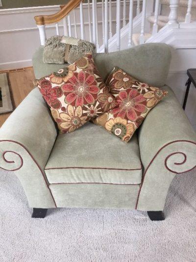 velvet chair with pillows